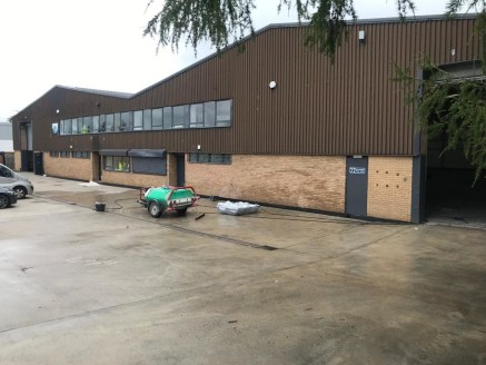 The property comprises of a detached, steel portal frame warehouse. The roof is clad in corrugated sheeting with GRP roof lights.  The unit has office and toilet areas and the eaves height is approximately 7 metres. Access is via two roller shutter d...