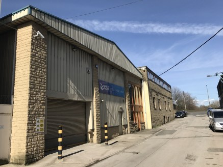 The property comprises two storey workshop accommodation with two storey offices of steel portal frame construction clad in artificial stone and uPvc coated steel decking beneath a uPvc plastosol coated steel decked roof incorporating perspex rooflig...