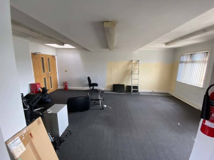 The premises is currently set up as an financial service offices on the ground floor with storage, kitchenette, and WC facilities to the rear with associated storage, WC, and a meeting room on the first. There is an outside area to the rear with park...