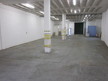 Refurbished, self-contained industrial / warehouse with large loading door and car parking.