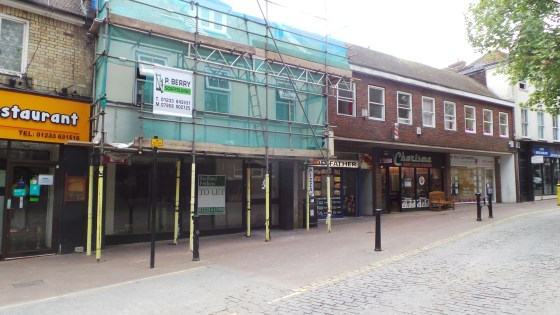 This mid-terrace lock-up shop property occupies a prominent location in the lower High Street in the centre of Ashford. It has an aluminium glazed shop front having a frontage of approximately 18 ft 6'' and a total built depth of 590 ft, narrowing to...