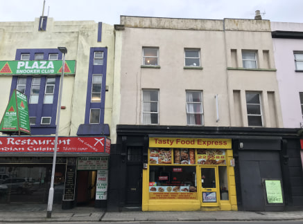 Bretonside is a mixed-use street with the majority of Ground Floors being used as retail or office premises for local covenants with upper floors used as residential accommodation in the forms of flats.   This block comprises a take away unit, two fl...