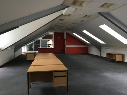 The vacant suite is on the second/attic floor of a larger two storey with attic and basement parking purpose-built office property, being of a steel frame construction with cladded elevations and a profile sheet insulated roof with Velux's.  Internal...