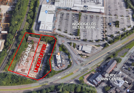 The site is situated fronting School Brow / Tanpits Lane, adjacent to Peel Way and the Woodfield Retail Park, which includes a Tesco supermarket; Boots; Next; Sports Direct; Scotts and McDonalds.