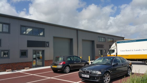The premises comprise a mid-terraced industrial warehouse built in 2015 constructed with a steel truss portal frame with brick/block and steel profile clad elevations. There is allocated car parking and ample loading bay provisions.  Internally the p...