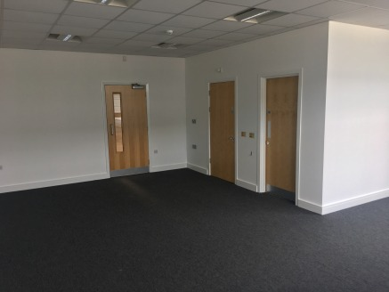 Large reception areas featuring male and female WC's and separate open plan office accommodation. Minimum eaves height of 5.3 m. 1 level access, full height loading door. hanging florescent box lighting. Concrete floor throughout. Gas fired heating....