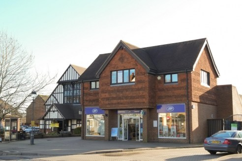 The property comprises an attractive stand-alone, two-storey building of mixed use, situated in the heart of Cranleigh. The building is constructed from fair-faced brick elevations that have been sympathetically tile-hung at first floor under a pitch...