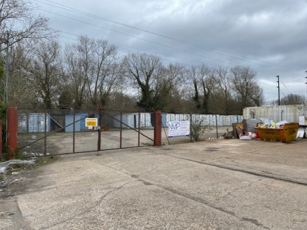 An area of land located within an established industrial location.  Site 2 (Right Hand Side)  Level ground, gated and fenced. There is a right of way for the owner of a unit at the rear to come through the site on a designated area. They lock the gat...