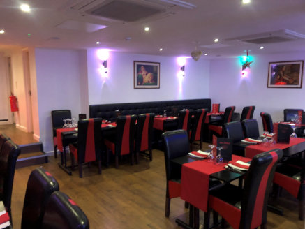 The subject property comprises a semi-detached mixed use building set over three levels with the ground floor currently operating as an Indian restaurant with the first and second floors providing a pair of self-contained flats.  The ground floor is...
