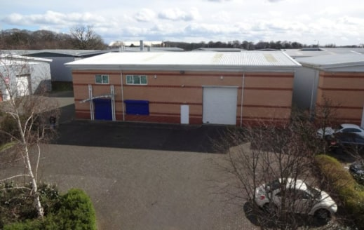 Description\n\nThe property comprises a detached industrial unit, with a self contained yard / car parking area.\n\nThe property benefits from 6.4m eaves and heating & lighting throughout....
