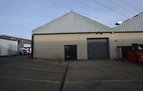 The property comprises an end of terrace single storey industrial unit of brickwork construction under a pitched sheet roof. Some of the internal space has been split up with partitions forming a separate office area. Externally, the property benefit...