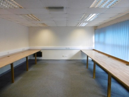 The property comprises a modern trade counter/industrial premises providing offices and warehouse. A single storey office with lobby, kitchenette and WC facilities is provided to the front of the unit with industrial area to the rear and roller shutt...