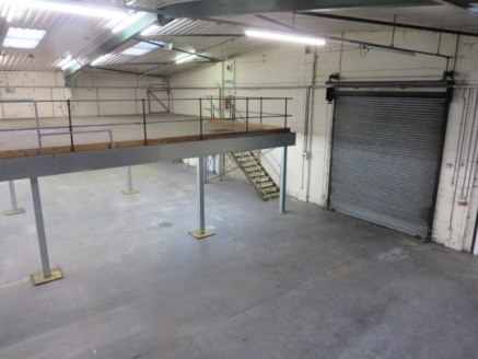 Semi-detached steel portal frame unit.<br><br>2 no. roll shutter doors. Clear eaves 4.5m.<br><br>Much of warehouse currently has purpose built mezzanine over extensive parking adjacent.<br><br>Ground Floor: 11,622 sq ft<br>First Floor: 9,951 sq ft<br...
