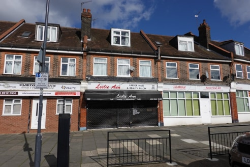 A ground floor shop with 2 self contained 1 bedroom flats, ideal for investment or owner occupiers use. The shop has traded for many years as a ladies hair and beauty salon and is divided into two areas which total approximately 802 sq ft. There is l...