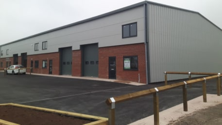 A new build mid terrace industrial/warehouse unit . Internally, the unit has a power floated concrete floor, with double glazed aluminium window and doors together with insulated up and over style loading door....