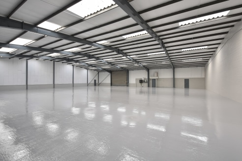 Portal frame construction. Steel profile cladding. Concrete floor. Sodium high bay lighting. All mains services connected. Ground level loading doors. Large self-contained secure yard. Less than 1 mile from J23 M6.