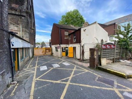 Freehold investment development opportunity  End of terrace building with yard space and separate building to the rear.