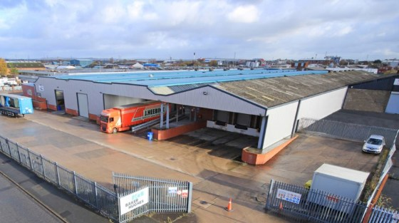 Suitable for distribution or manufacturing. Fully secure site. Dock & level access loading. Substantial power supply. High quality offices/showroom. The property is available to let by way of a new FRI lease, terms to be agreed. Alternatively conside...