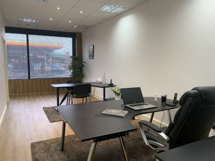 A ground floor commercial former lock-up shop unit measuring 691 sq ft and recently re-fitted and refurbished as modern office space arranged as two large suites with suspended ceilings, hard-wood flooring and full air conditioning. To the rear of th...
