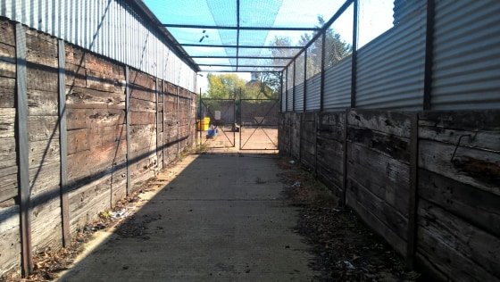 Concreted and fenced self-contained yard measuring approximately 0.66 of an acre.  The yard contains a basic warehouse building together with a small office which includes WC's and a small kitchenette.   There are two small other temporary structures...