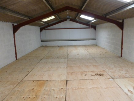 LOW COST STORAGE PREMISES TO LET - The premises form part of a courtyard complex comprising agricultural barns, workshops and storage units. Externally, there is a good sized shared forecourt area providing parking and facilities for loading and unlo...