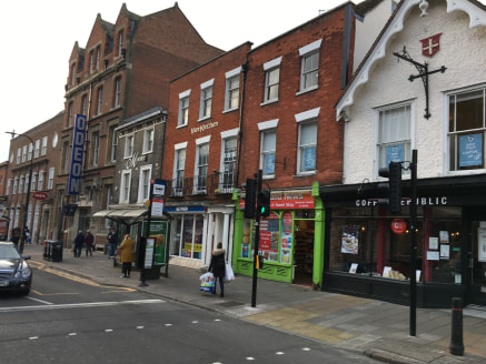 The property benefits from an extensive frontage to both Head Street and Church Street and comprises open plan sales area with suspended ceiling and air conditioning (not tested).