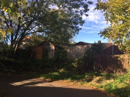 Potential rear garden plot.   Plot generally level once accessed.  Secluded lane location.