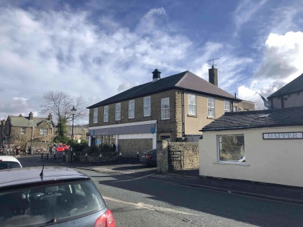 The property comprises an attractive detached building constructed in stone and set under a pitched slate roof. The available accommodation is on the first floor above the trading store which is accessed to the front right of the property. Internally...