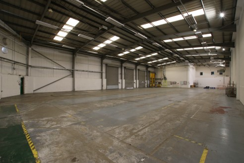 The property comprises a modern detached warehouse facility of steel portal frame with an insulated metal profile sheet roof incorporating translucent panels, part brick and metal profile cladding to the elevations. The unit benefits from the followi...