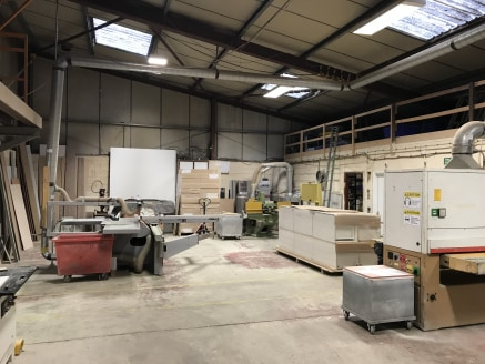 The property comprises a detached part single and part two storey industrial unit plus a small yard / forecourt area at the front of the site.   Internally, the property is arranged to provide two workshop areas which are separated by a blockwork wal...