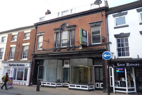 The property is a Grade II Listed building with a split double bay frontage and providing a generous split level retail area. To the rear is a storage area, disabled W.C and rear double door for loading/unloading. There is parking at the rear for 1 o...