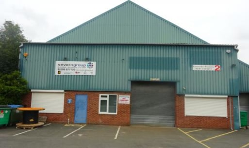 "The unit is of steel framed construction with brick/blockwork and metal profiled sheeted walls surmounted by pitched metal profiled sheeted roofs incorporating filon roof lights. Height to eaves - maximum 6.69 m (21' 11"") approx. Access is via a roll..."