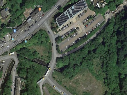 The property comprIses a small parcel of land extendIng to 0.69 acres (0....