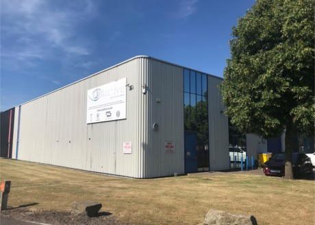 Description  The property comprises an end-terraced light industrial/warehouse unit built during the early 1980s.   There is a forecourt at the front for parking.   The interior comprises various sized workrooms and offices at ground level with open...