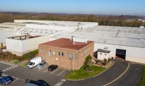 The property comprises a substantial detached warehouse facility with attached two-storey office block on a self-contained site including a generous tarmacadam car park to the front.<br><br>The warehouse is of steel portal frame construction, arrange...