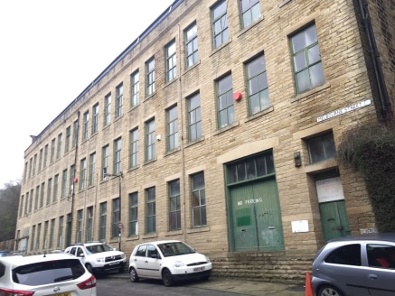 The property comprises an imposing four storey traditional stone built former textile mill exhibiting traditional mill features with internal staircase serving all floors on the interior eastern gable elevation and having principle access directly of...