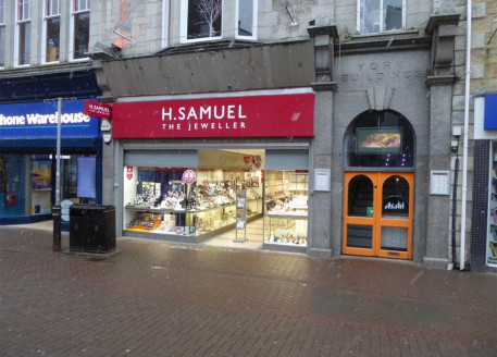 Ground floor lock-up shop in prime retail area. Retail area 1,203 sq ft (111.8 sq m). Currently fitted out as a jewellers to include rear staff area, store room, small office area and toilets....