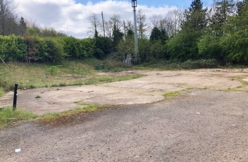 The property comprises an open yard extending to approximately 0.25 acres (0.16 hectares), which essentially comprises of rough ground with some stoned and concreted areas. The site is securely fenced to the front and sides, with mature hedgerows alo...