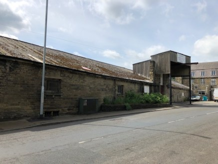The property briefly comprises a two storey stone built mill accessed at ground floor level via 1.58M wide x 2.1M high double timber doors with covered loading directly off Halifax Road. Internally the ground floor benefits from a minimum working eav...