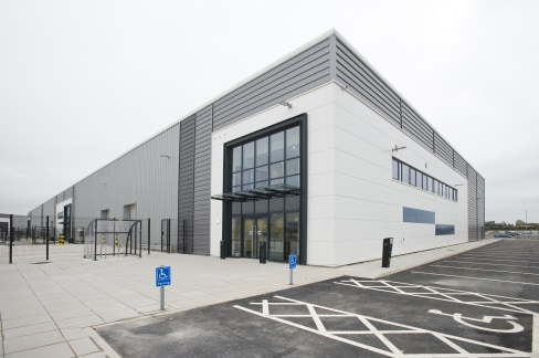 Steel portal framed buildings with feature glazing to offices. 7 - 8 metres internal eaves height. Electrically operated level access doors. 37.5 KN/m2 floor loading. All mains services and drainage connections. Separate dedicated car parking areas a...