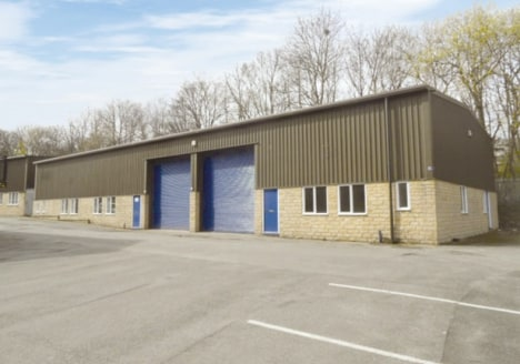 The property forms part of a parade of modern purpose built industrial units of steel portal framed construction with artificial stone elevations and plastic coated profiled metal sheet cladding above.  The unit benefits internally from a solid concr...