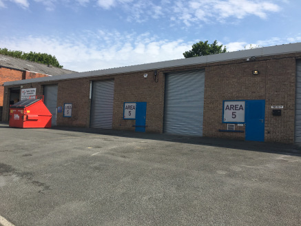 The property briefly comprises a double terraced industrial unit clad in brick with drive-in access provided by two steel roller shutter doors (3.15M wide by 3.96M high). Internally the property has a solid concrete floor throughout, a minimum intern...