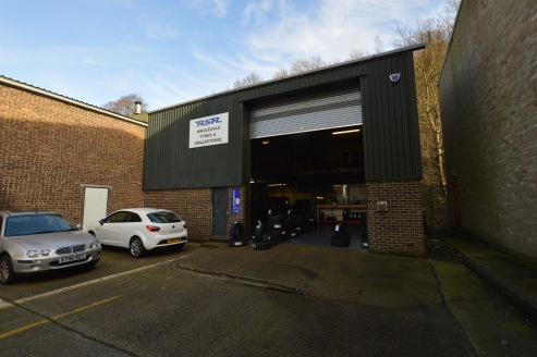 The property is of blockwork construction with corrugated sheet roofing under a portal framed warehouse.  The main unit has ground and first floor offices and benefits from two concertina loading doors to the front of the premises and an up and over...