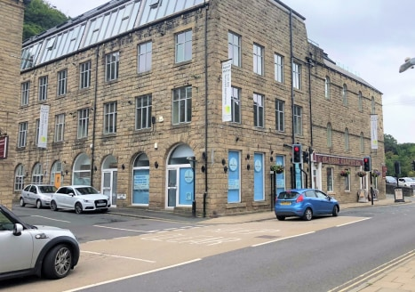 The premises briefly comprise two fully let retail units located on the ground floor of a larger stone built building positioned within a prominent location in Hebden Bridge Town Centre.  Shop 1 occupies a corner position fronting onto Albert Street...