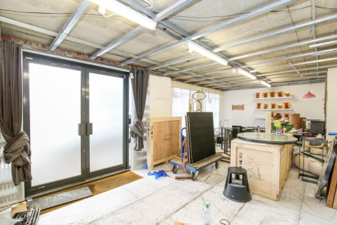 The unit is found within a new build property with a basic fit out. The property is currently being used as an artist's studio. Found on the ground floor, the unit has large windows at the front of the property, a W.C and small kitchenette installed....