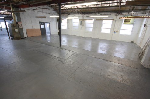 p>\n A traditional factory unit constructed of brickwork walls with steel trusses and lined roof in part with clear roof lights and three roller shutter access doors. The unit has recently been redecorated and the first floor offices have had new flo...