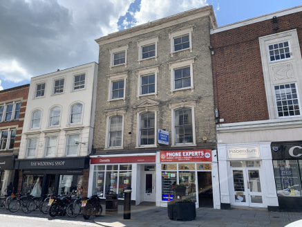 The subject property is located in the heart of the town centre on the High Street close to its junction with Head Street. The property has a self-contained rear pedestrian access via Culver Street West.   Internally the premises consists of three va...