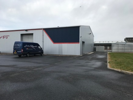 The property comprises an end bay steel portal framed warehouse with integral office and WC accommodation with external loading on to a surfaced yard/car park. There is an additional mezzanine floor within the warehouse which is accessed via a metal...
