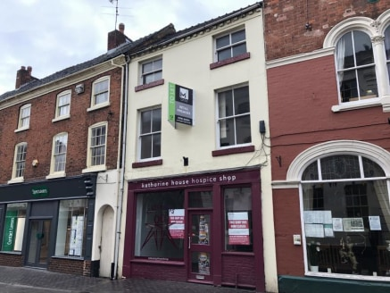 The property is a self-contained three storey building with\n\nrear single storey extension of concrete panel construction\n\nand parking for one vehicle from Christchurch Way.\n\nThe ground floor consists of a front retail/reception area,\n\nleading...