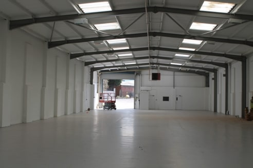 "Portal frame warehouse * Approx heIght to eaves 17ft 3"" (5.3m) * ElectrIc roller shutter per unIt approx. 15ft (4.6m) wIde by14ft (4...."
